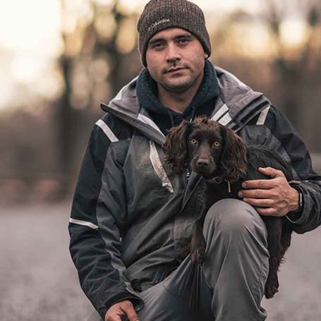 Will the trainer holding a brown dog he's currently training.